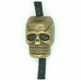 Perle tête de mort métal , 11x7 mm bronze x 1